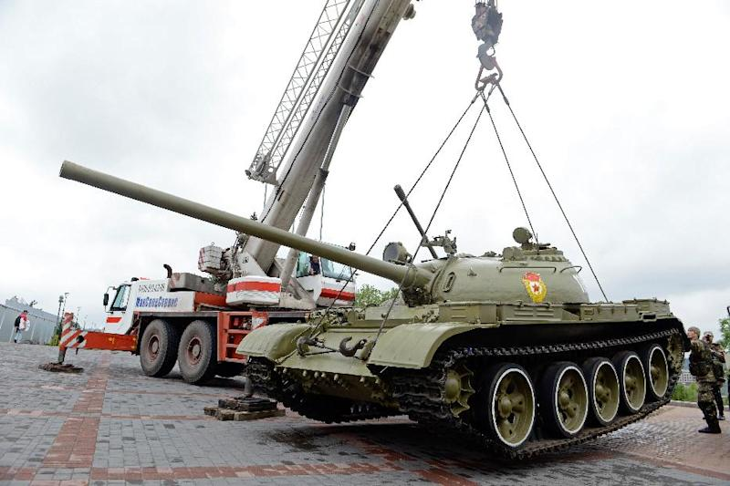 Pro-Russian militants use a crate to lift a T-54 Soviet-era medium tank from the WWII open-air museum in the eastern Ukrainian city of Donetsk on July 7, 2014 to use it against Ukrainian forces