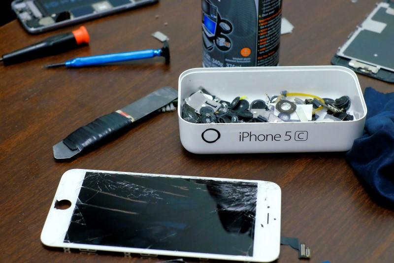 Pieces of an iPhone are seen in a repair store in New York