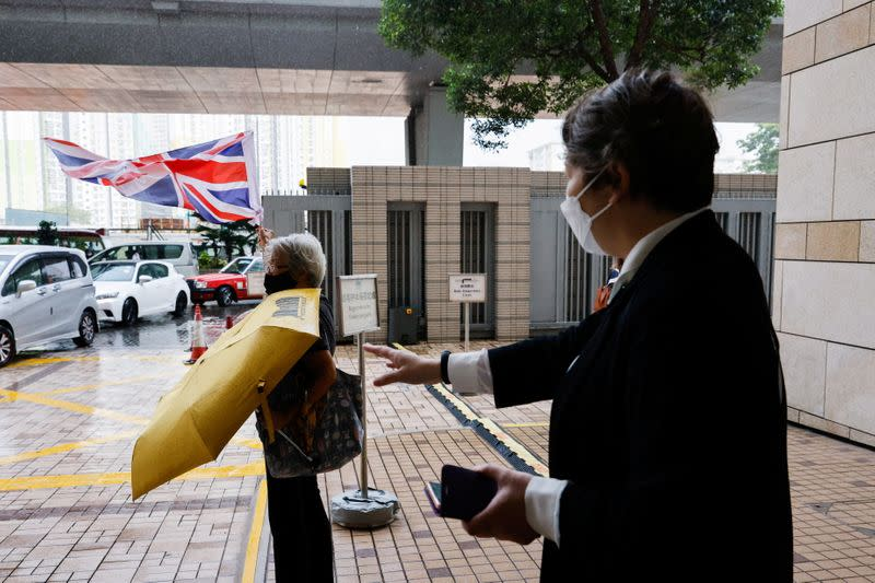 Pro-democracy activist Alexandra Wong shouts at West Kowloon Magistrates's Courts building, to support 47 pro-democracy activists who charged with conspiracy to commit subversion under the national security law, in Hong Kong