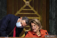 Sen. John Barrasso, R-Wyo., left, and Sen. Shelley Moore Capito, R-W.Va., speak as administrator of the Environmental Protection Agency nominee Michael Regan, testifies during his confirmation hearing before the Senate Environment and Public Works committee on Capitol Hill in Washington, Wednesday, Feb. 3, 2021. (Caroline Brehman/Pool via AP)