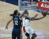 Washington Wizards guard Bradley Beal (3) shoots past New Orleans Pelicans center Steven Adams (12) in the first quarter of an NBA basketball game in New Orleans, Wednesday, Jan. 27, 2021. (AP Photo/Derick Hingle)