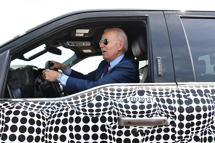 US President Joe Biden drives a F150 electric truck at the Ford Dearborn Development Center in Dearborn, Michigan on May 18, 2021.
