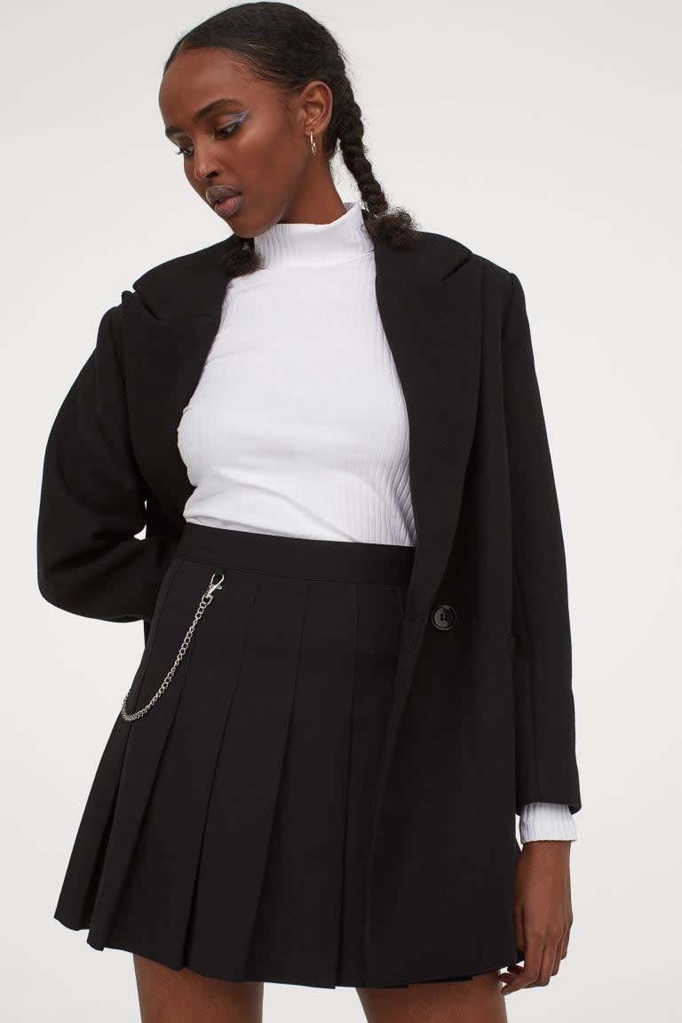 <p>This <span>H&amp;M Pleated Skirt</span> ($25) is a nostalgic style we're getting back into. We like the edgy detail of the chain.</p>
