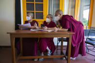 Exile Tibetan Buddhist nuns wait for other nuns to register for their COVID-19 vaccination at the Jamyang Choeling Buddhist Dialectic Nunnery near Dharmsala, India, Saturday, June 26, 2021. (AP Photo/Ashwini Bhatia)