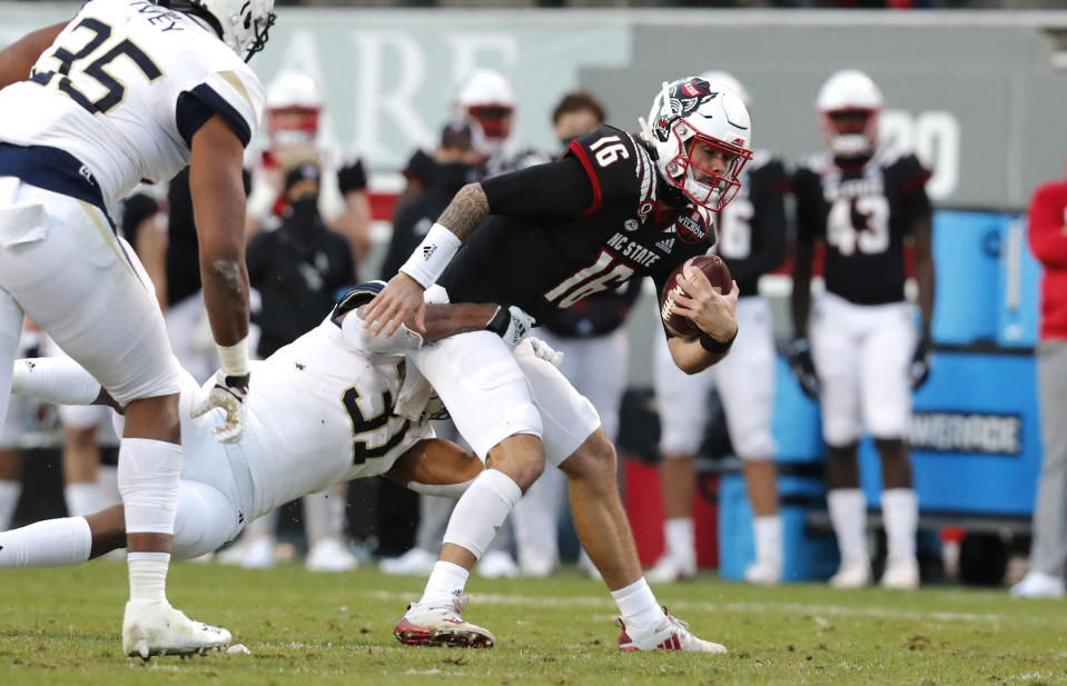 Georgia Tech defensive lineman Kyle Kennard (31) sacks North Carolina State quarterback Bailey Hockman (16) during the first half of an NCAA college football game in Raleigh, N.C., Saturday, Dec. 5, 2020. (Ethan Hyman/The News & Observer via AP, Pool)