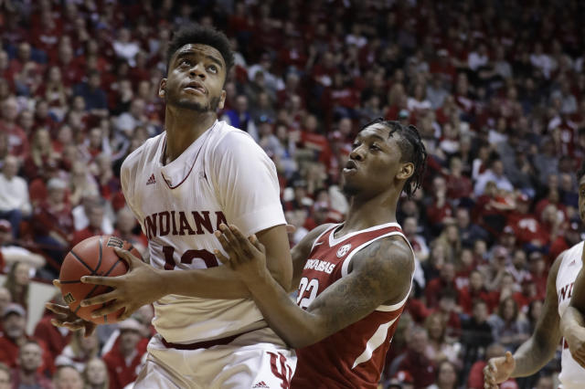 Indiana's Juwan Morgan (13) puts up a shot against Arkansas's Gabe Osabuohien (22) during the second half in the second round of the NIT college basketball tournament, Saturday, March 23, 2019, in Bloomington, Ind. Indiana won 63-60. (AP Photo/Darron Cummings)