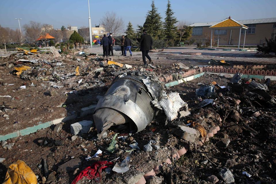 Rescue teams work amidst debris after a Ukrainian plane carrying 176 passengers crashed: AFP via Getty Images