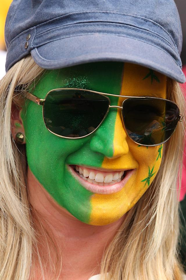 BRISBANE, AUSTRALIA - NOVEMBER 11:  Australian fan cheers during day three of the First Test match between Australia and South Africa at The Gabba on November 11, 2012 in Brisbane, Australia.  (Photo by Chris Hyde/Getty Images)