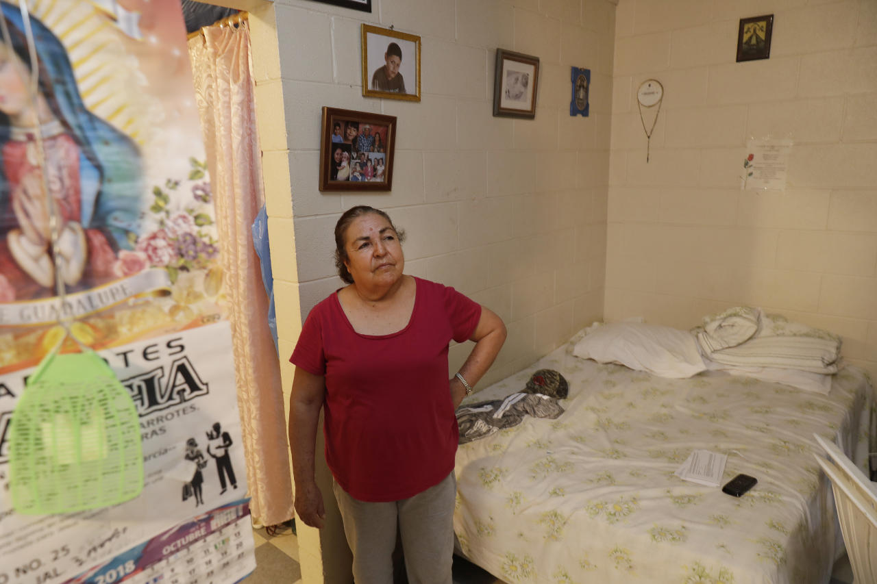 In this Wednesday, Sept, 19, 2018, photo, farmworker Marina Soto shows the inside of her one bedroom apartments which she shares with her husband and son in Huron, Calif. The region is unrivaled for farm production, but the rich earth has not given back equally to those who toil out of view of millions of tourists and Californians who pass through the valley each year. (AP Photo/Marcio Jose Sanchez)