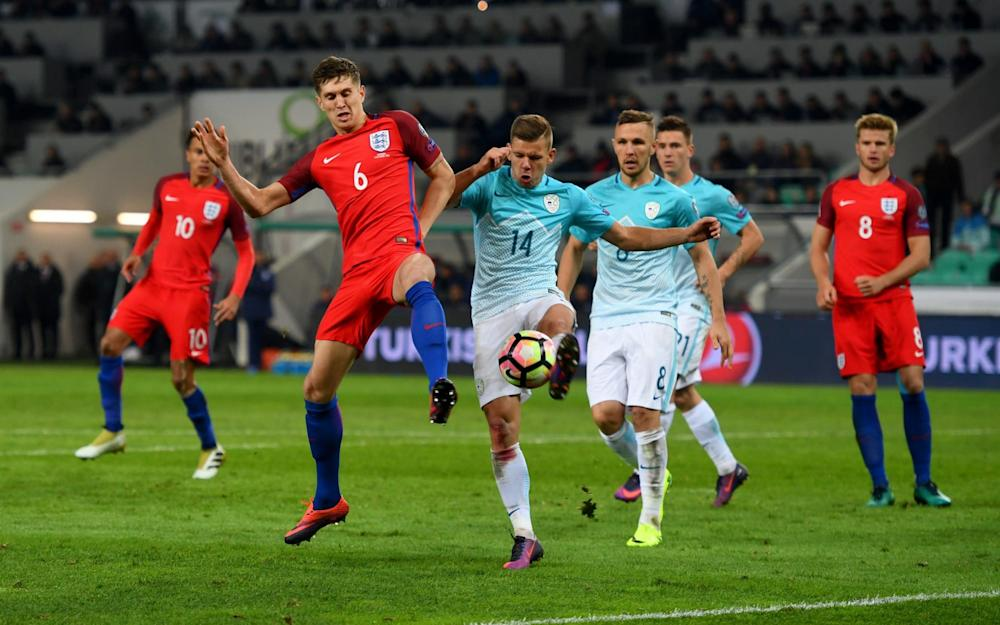 Slovenia v England Qualifying Original description: LJUBLJANA, SLOVENIA - OCTOBER 11: John Stones of England battles for the ball with Roman Bezjak of Slovenia during the FIFA 2018 World Cup Qualifier Group F match between Slovenia and England at Stadion Stozice on October 11, 2016 in Ljubljana, Slovenia.  - Credit: Michael Regan/The FA via Getty Images