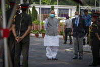 Indian Defense Minister Rajnath Singh waits for the arrival of his Australian counterpart Peter Dutton for a Guard of Honor in New Delhi, India, Friday, Sept. 10, 2021. (AP Photo/Altaf Qadri)