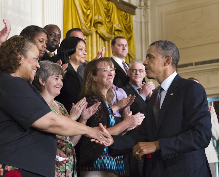 President Barack Obama greets event participants after announcing his plan to extend tax cuts for the middle class, in the East Room of the White House in Washington, Monday, July 9, 2012. (AP Photo/J. Scott Applewhite)