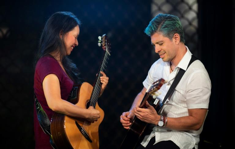Rodrigo Sanchez (R) and Gabriela Quintero of the Mexican duo Rodrigo y Gabriela before a concert at the McKittrick Hotel in New York