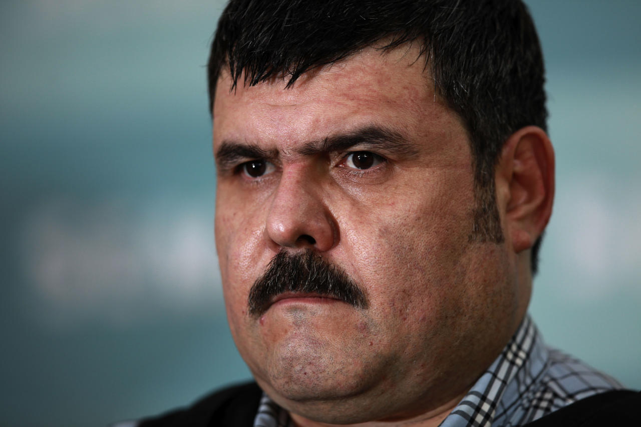 """The alleged leader of the Gulf drug cartel, Jorge Eduardo Costilla Sanchez, aka """"El Coss,"""" is shown during a media presentation at the Mexican Navy's Center for Advanced Naval Studies in Mexico City,Thursday, Sept. 13, 2012. One of Mexico's most-wanted men, the 41-year-old is charged in the U.S. with drug-trafficking and threatening U.S. law enforcement officials. U.S. authorities offered $5 million for information leading to his arrest. (AP Photo/Dario Lopez-Mills)"""