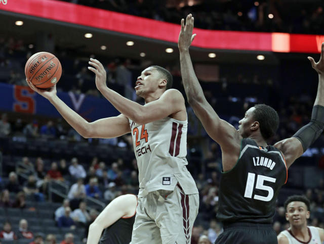 Virginia Tech's Kerry Blackshear Jr. (24) drives past Miami's Ebuka Izundu (15) during the second half of an NCAA college basketball game in the Atlantic Coast Conference tournament in Charlotte, N.C., Wednesday, March 13, 2019. (AP Photo/Nell Redmond)