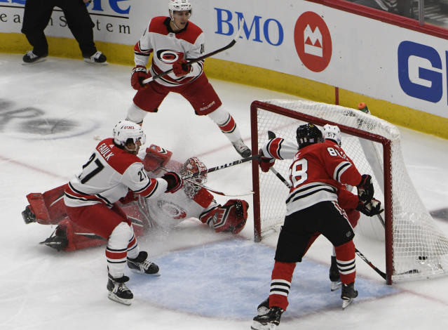 Chicago Blackhawks right wing Patrick Kane (88) scores a goal on Carolina Hurricanes goaltender Scott Darling, second left, during the second period of an NHL hockey game Thursday, Nov. 8, 2018, in Chicago. (AP Photo/David Banks)