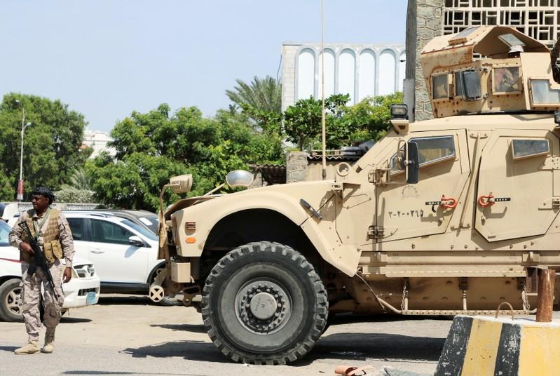 FILE PHOTO: Saudi soldier walks past an armored personnel carrier outside a hospital during the delivery of Saudi medical aid in Aden
