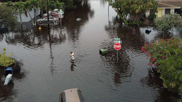 PHOTO: An aerial view from a drone shows a woman crossing a street inundated with flood water, Dec. 23, 2019, in Hallandale, Fla. (Joe Raedle/Getty Images)