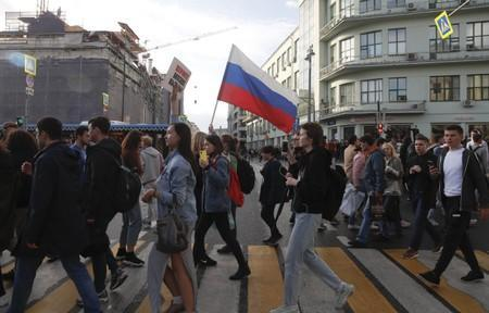 Participants of a procession are seen after a rally to demand authorities allow opposition candidates to run in a local election in Moscow