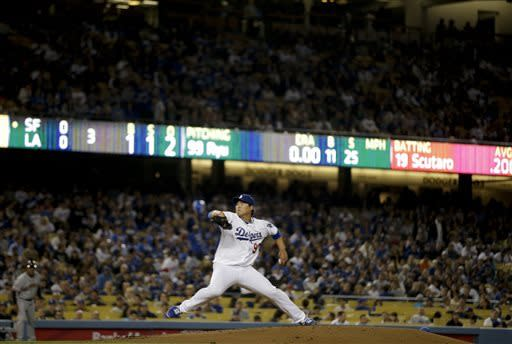 Los Angeles Dodgers starting pitcher Hyun-Jin Ryu, of South Korea, throws against the San Francisco Giants during the third inning of a baseball game in Los Angeles, Tuesday, April 2, 2013. (AP Photo/Jae C. Hong)
