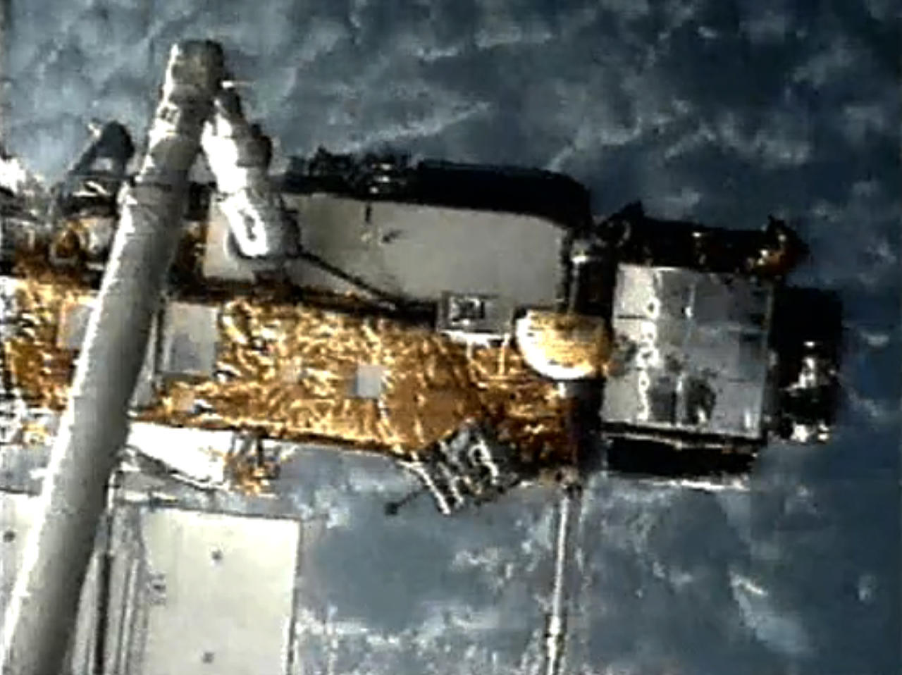 This screen grab image provided by NASA shows UARS attached to the robotic arm of the space shuttle Discovery during mission STS-48 in 1991, when UARS was deployed. NASA scientists are doing their best to tell us where a plummeting 6-ton satellite will fall later this week. It's just that if they're off a little bit, it could mean the difference between hitting Florida or New York. Or, say, Iran or India. (AP Photo/NASA)