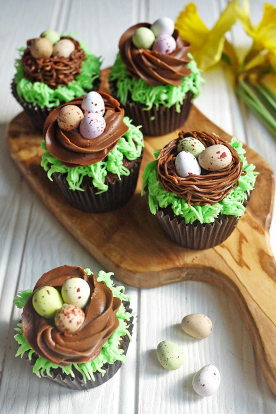 """<p>These cupcakes are layered with chocolate on top of chocolate... on top of <a href=""""https://www.housebeautiful.com/shopping/g1385/gourmet-easter-chocolates-0313/"""" rel=""""nofollow noopener"""" target=""""_blank"""" data-ylk=""""slk:chocolate"""" class=""""link rapid-noclick-resp"""">chocolate</a>. No complaints here. </p><p>Get the full recipe from <a href=""""https://www.tamingtwins.com/easter-chocolate-nest-mini-egg-cupcakes-kids-cooking/"""" rel=""""nofollow noopener"""" target=""""_blank"""" data-ylk=""""slk:Taming Twins"""" class=""""link rapid-noclick-resp"""">Taming Twins</a>.</p>"""