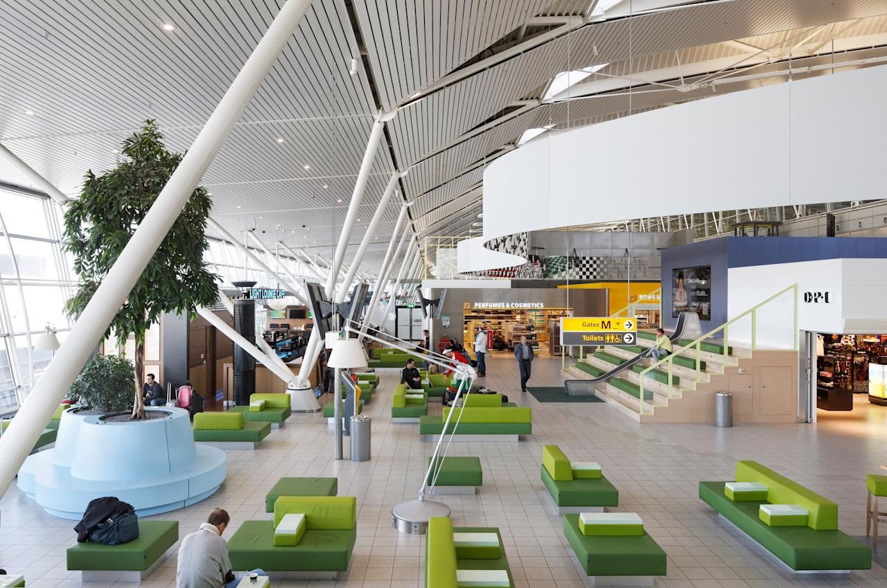 """One of the closest major airports to its <a href=""""https://www.cntraveler.com/destinations/amsterdam?mbid=synd_yahoo_rss"""">home city</a>, KLM's main hub is a mere 11 minutes from the city center by train. But this airport is a destination in itself, with enough airside shopping and cuisine to get you through any layover. Dozens of duty-free stores feature monthly deals; other perks travelers won't experience elsewhere include a wide selection of tulip seeds and bulbs for sale, and an outpost of the famed <a href=""""https://www.cntraveler.com/activities/amsterdam/rijksmuseum?mbid=synd_yahoo_rss"""">Rijksmuseum</a>, with a rotating selection of works from one of the world's leading art collections."""