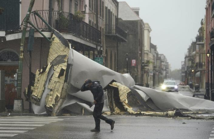 """<span class=""""caption"""">Hurricane Ida's winds tore off roofs, including in New Orleans' French Quarter.</span> <span class=""""attribution""""><a class=""""link rapid-noclick-resp"""" href=""""https://newsroom.ap.org/detail/APTOPIXTropicalWeatherAtlantic/8d34a9cf7a294a3b980415af25a2e64f/photo"""" rel=""""nofollow noopener"""" target=""""_blank"""" data-ylk=""""slk:AP Photo/Eric Gay"""">AP Photo/Eric Gay</a></span>"""