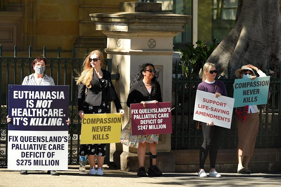 Protesters against the voluntary assisted dying bill outside Brisbane's parliament house last week
