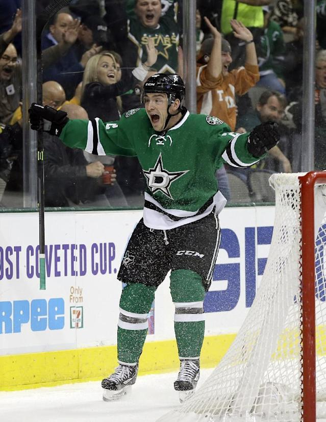 Dallas Stars center Colton Sceviour celebrates his goal against the Vancouver Canucks during the first period of an NHL hockey game, Thursday, Dec. 19, 2013, in Dallas. (AP Photo/Tony Gutierrez)
