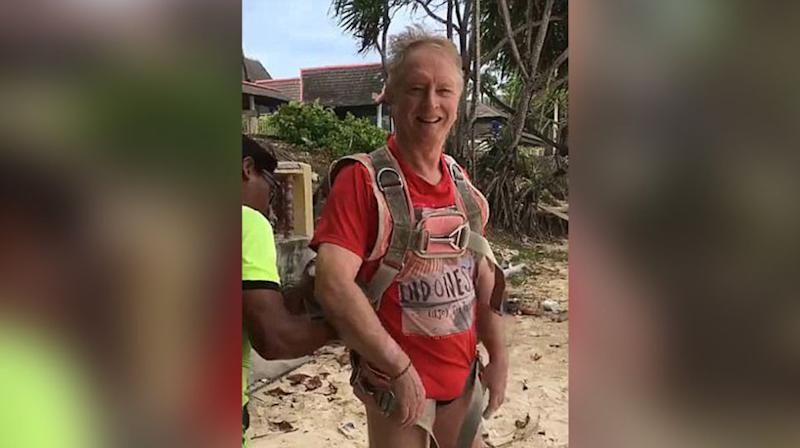 Roger John Hussey smiled at his wife while his instructor tightened his harness. Source: 7 News