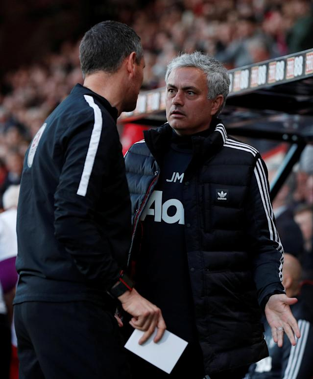 """Soccer Football - Premier League - AFC Bournemouth vs Manchester United - Vitality Stadium, Bournemouth, Britain - April 18, 2018 Manchester United manager Jose Mourinho speaks with fourth official Andre Marriner before the match Action Images via Reuters/John Sibley EDITORIAL USE ONLY. No use with unauthorized audio, video, data, fixture lists, club/league logos or """"live"""" services. Online in-match use limited to 75 images, no video emulation. No use in betting, games or single club/league/player publications. Please contact your account representative for further details."""