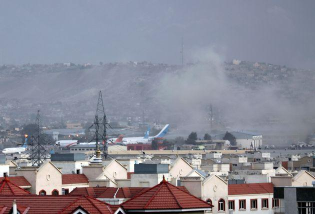 Smoke rises from explosion outside the airport in Kabul, Afghanistan, Thursday, Aug. 26, 2021. (Photo: Wali Sabawoon via AP)