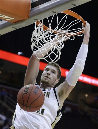 Western Michigan's Shayne Whittington dunks against Eastern Michigan in the first half during an NCAA college basketball game at the Mid-American Conference men's tournament on Thursday, March 14, 2013, in Cleveland. (AP Photo/Tony Dejak)