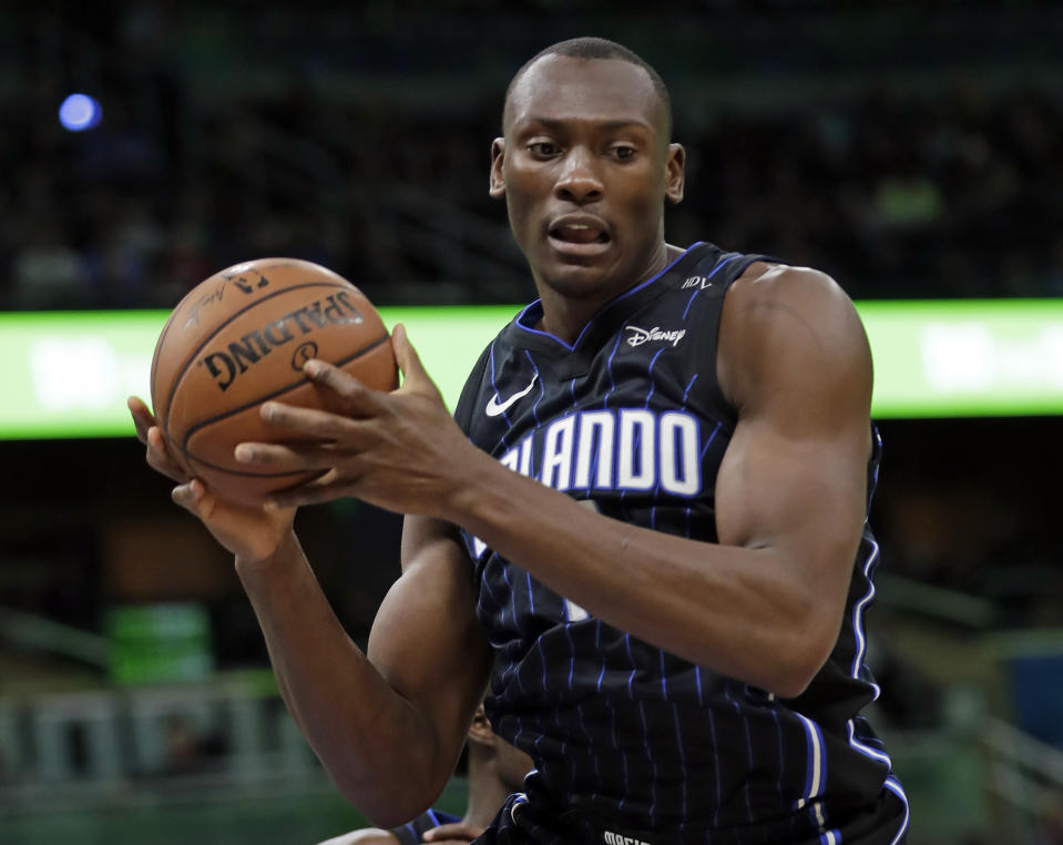 Bismack Biyombo is reportedly headed back to Charlotte in a three-team trade involving the Chicago Bulls and Orlando Magic. (AP)