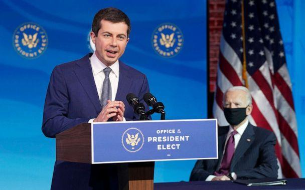 PHOTO: Former South Bend, Ind. Mayor Pete Buttigieg, President-elect Joe Biden's nominee to be transportation secretary reacts to his nomination as Biden looks on during a news conference at The Queen theater in Wilmington, Del., Dec. 16, 2020.  (Kevin Lamarque/AP)