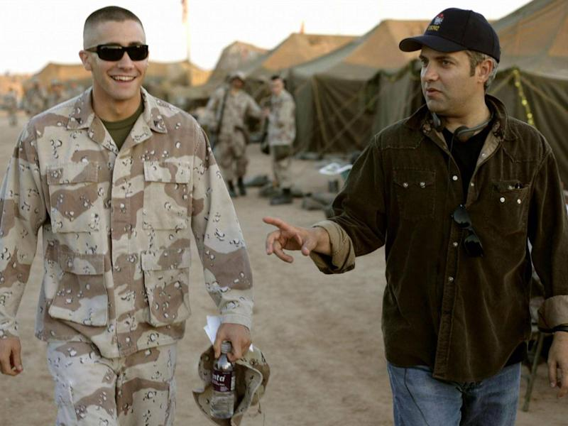 Gyllenhaal on the set of 2005 biographical war drama 'Jarhead', with director Sam Mendes