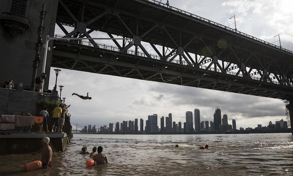 Swimmers jump into the Yangtze River in Wuhan, China, on 6 July 2020.