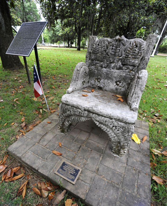 A monument to Confederate President Jefferson Davis, that was previously stolen, is shown back at its regular site at a cemetery in Selma, Ala., on Wednesday, June 2, 2021. Three people were charged following the disappearance of the chair, which was recovered in New Orleans and is now glued down. (AP Photo/Jay Reeves)