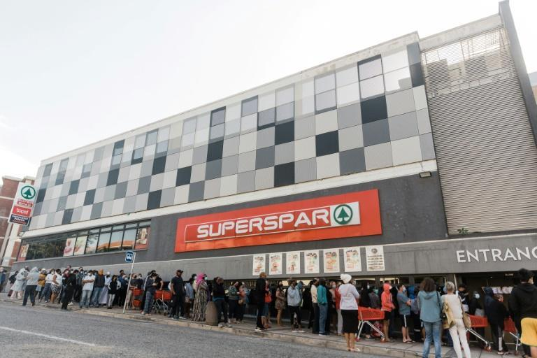 People queued to enter a supermarket in Durban on Tuesday after other stores were ransacked