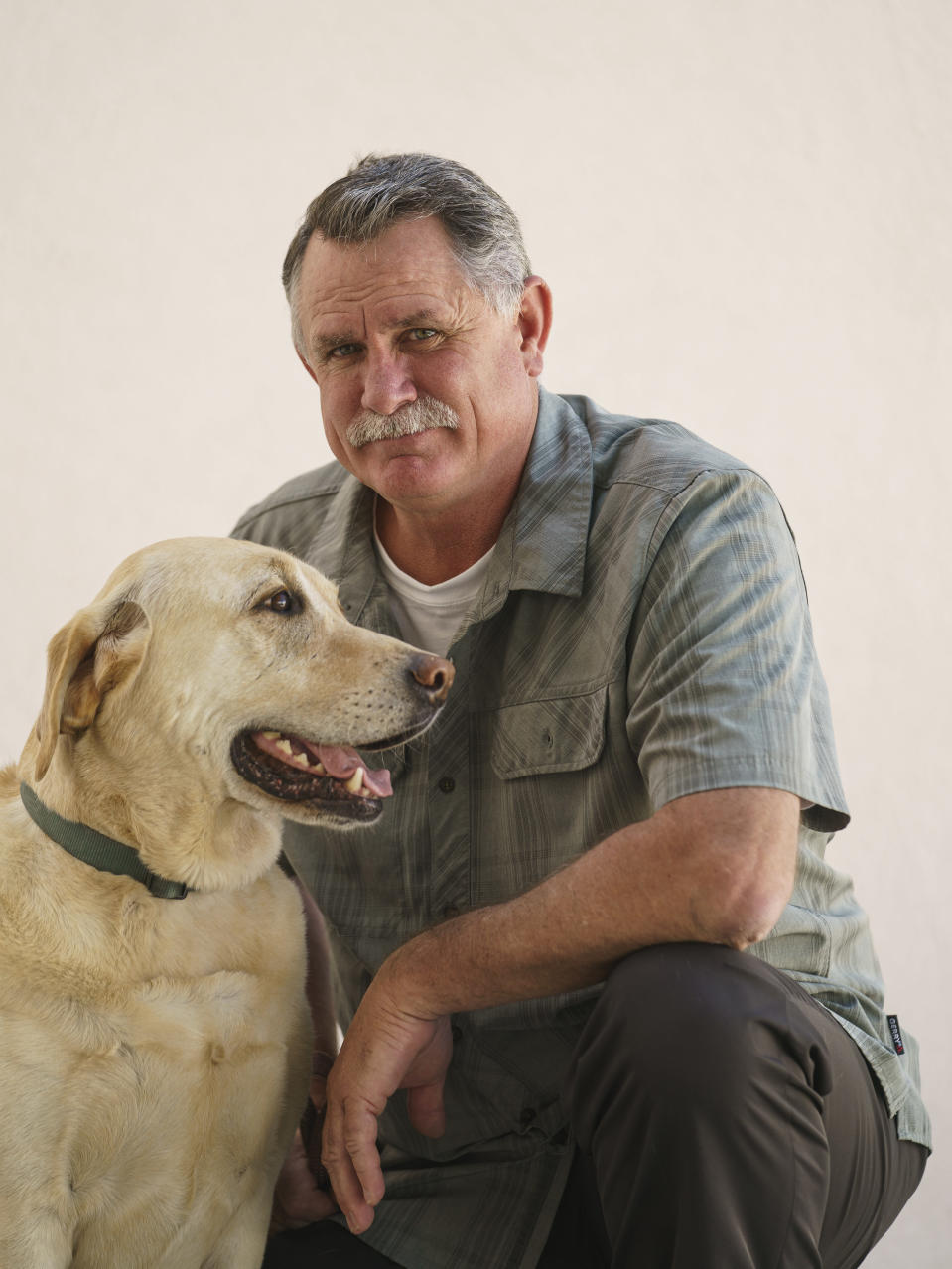 Orrin Heatlie, the main organizer for the Recall of California Gov. Newsom campaign, poses with his service dog Bailey after recording a radio program at the KABC radio station in Culver City, Calif., Saturday, March 27, 2021. (AP Photo/Damian Dovarganes)