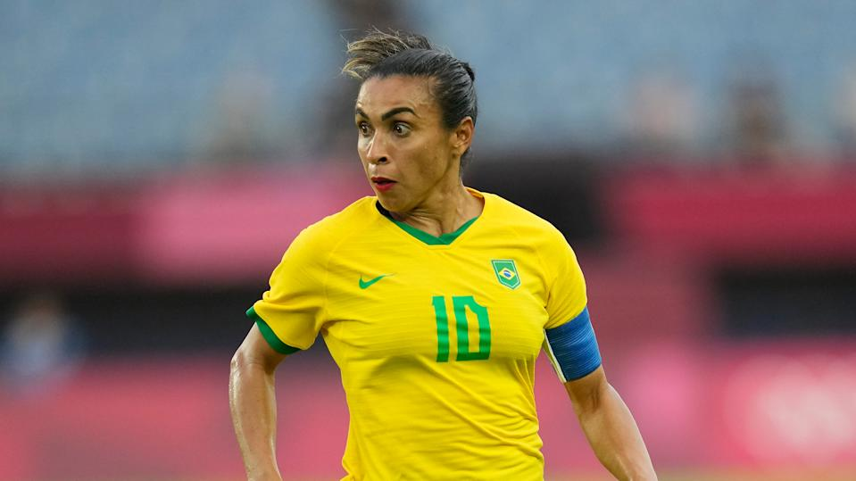 Brazil's Marta dribbles the ball against China during a women's soccer match at the 2020 Summer Olympics, Wednesday, July 21, 2021, in Rifu, Japan. (AP Photo/Andre Penner)
