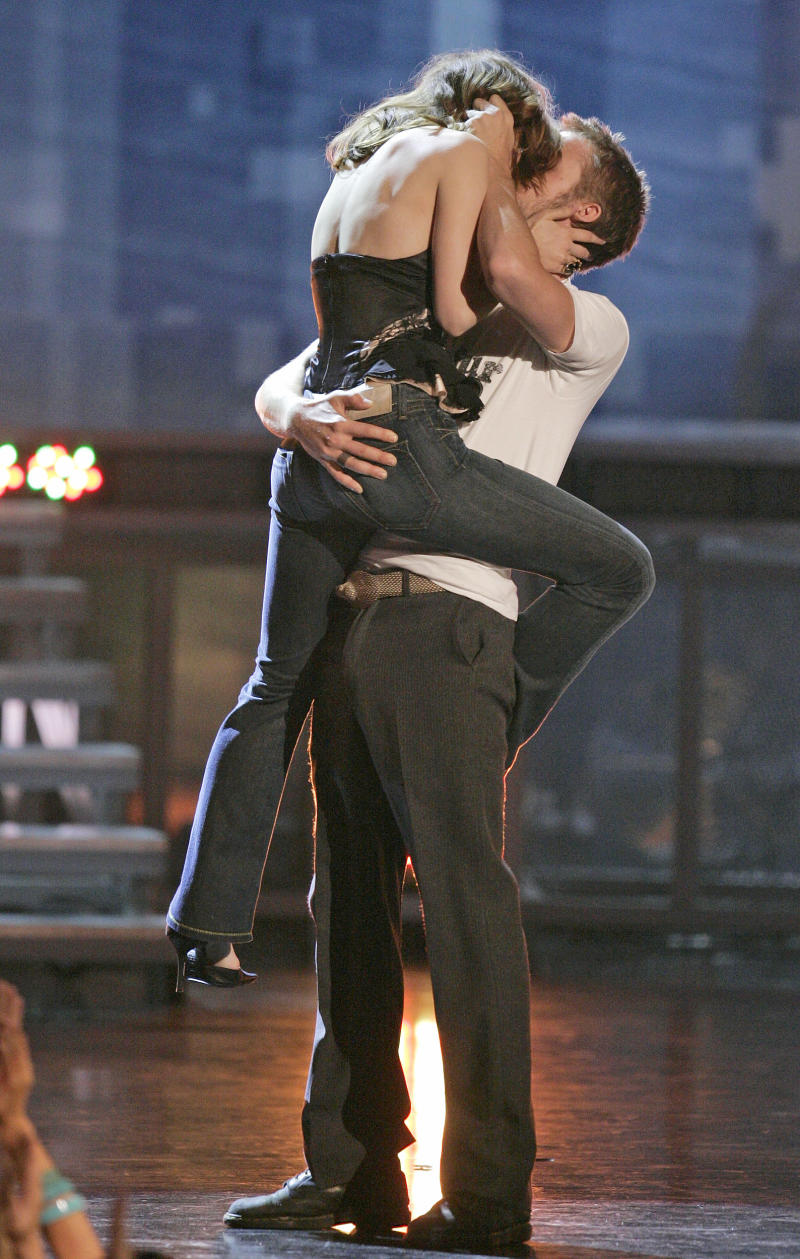"Rachel McAdams and Ryan Gosling kiss on stage as they accept the award for best kiss for their work in ""The Notebook,"" during the MTV Movie Awards on Saturday, June 4, 2005, in Los Angeles. (AP Photo/Mark J. Terrill)"
