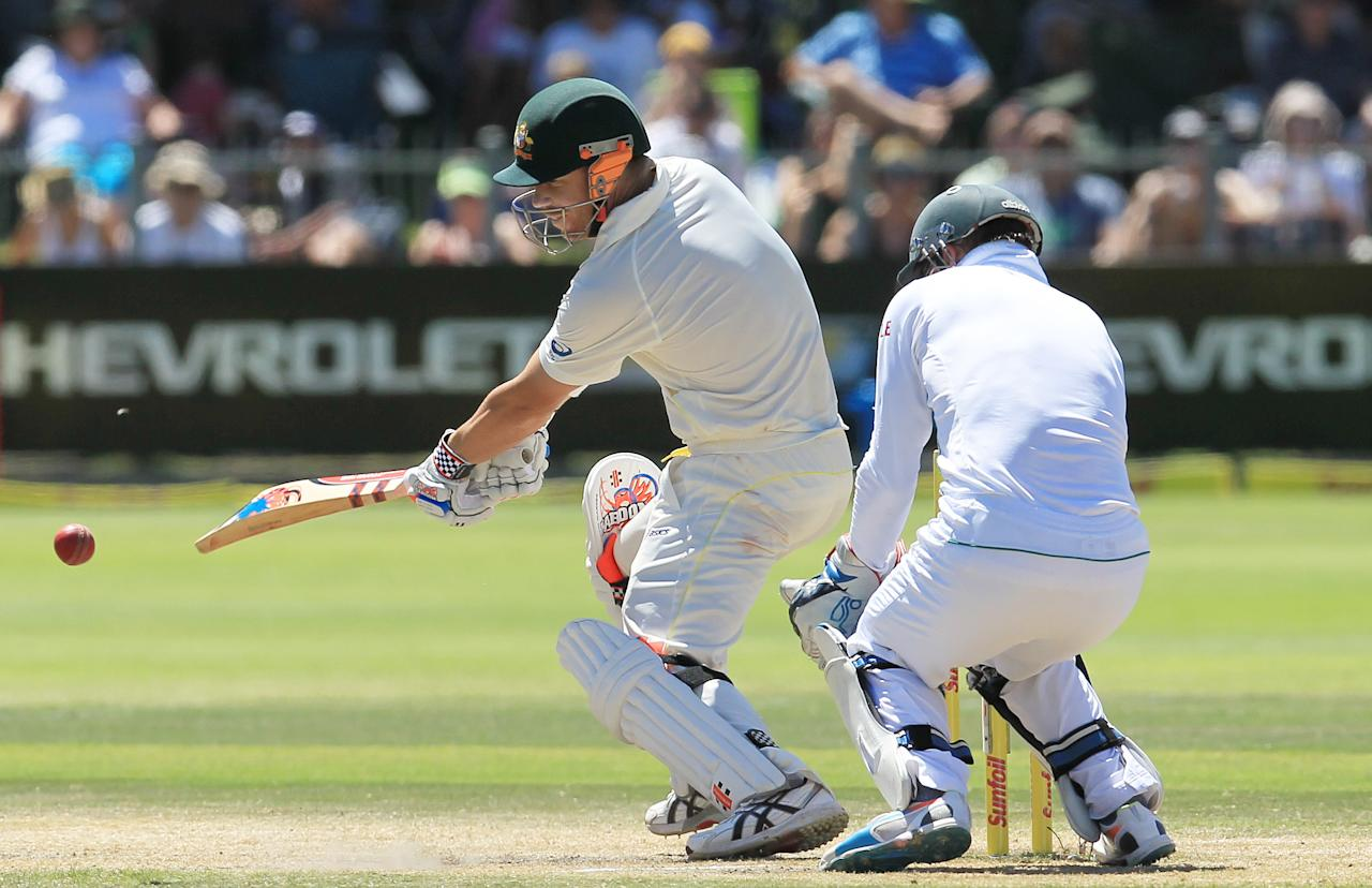 Australia's batsman David Warner, left, plays a side shot as South Africa's wicketkeeper AB de Villiers, right, watches on the fourth day of their 2nd cricket test match at St George's Park in Port Elizabeth, South Africa, Sunday, Feb. 23, 2014. (AP Photo/ Themba Hadebe)