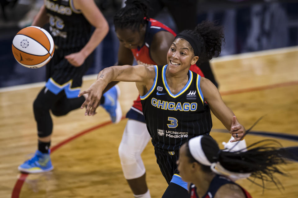 Chicago Sky forward Candace Parker passes the ball against the Washington Mystics during the first half of their opening game on May 15, 2021 in Washington, D.C. (Scott Taetsch/Getty Images)