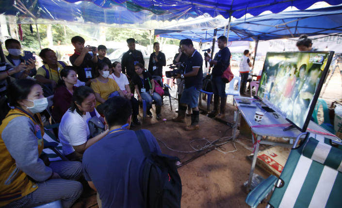 <p>Family members of the 12 boys and their soccer coach watch a video clip of 12 boys on television after they were found alive, in Chiang Rai Province, in northern Thailand, Wednesday, July 4, 2018. (Photo: Sakchai Lalit/AP) </p>