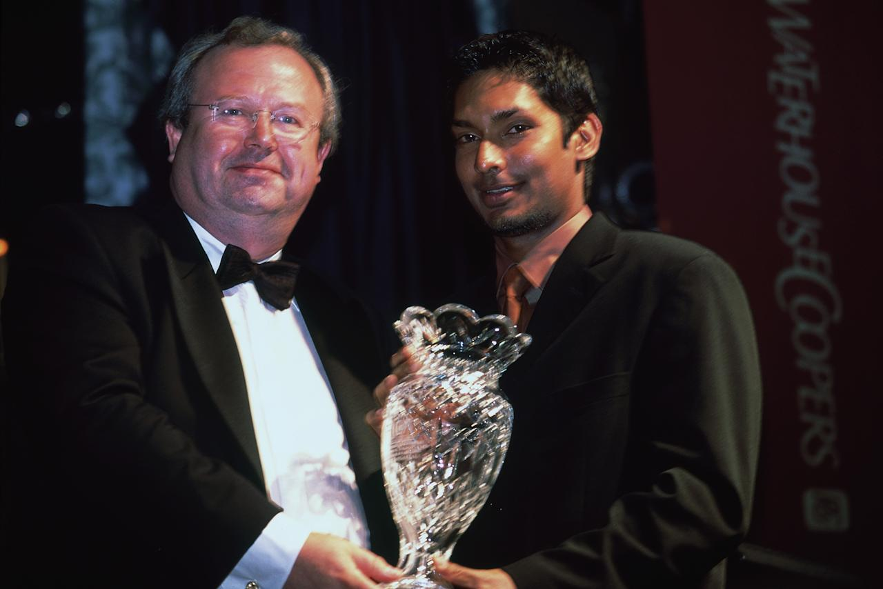 LONDON - JULY 10th :  Kumar Sangakkara is presented his award by Kieran Poynter during the FICA International Cricket Awards held at the Dorchester Hotel, London on the 10th July 2002.(Photo By Bryn Lennon/Getty Images)