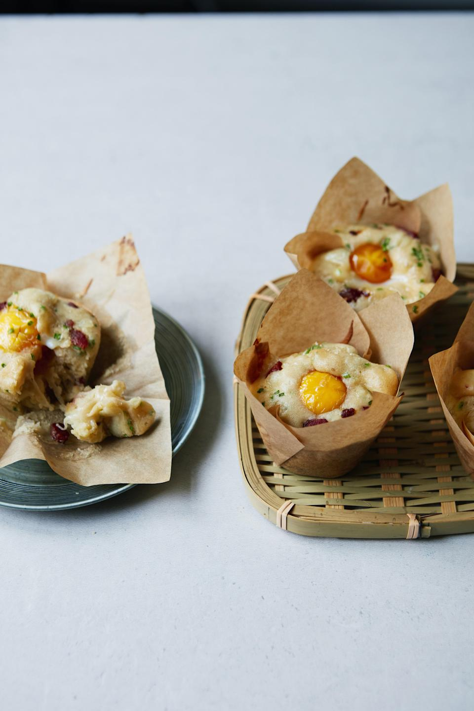 """This pancake-like muffin is studded with bacon and tomatoes and topped with a bright, yellow egg yolk. <a href=""""https://www.epicurious.com/recipes/food/views/korean-egg-bread-gyeran-bbang?mbid=synd_yahoo_rss"""" rel=""""nofollow noopener"""" target=""""_blank"""" data-ylk=""""slk:See recipe."""" class=""""link rapid-noclick-resp"""">See recipe.</a>"""