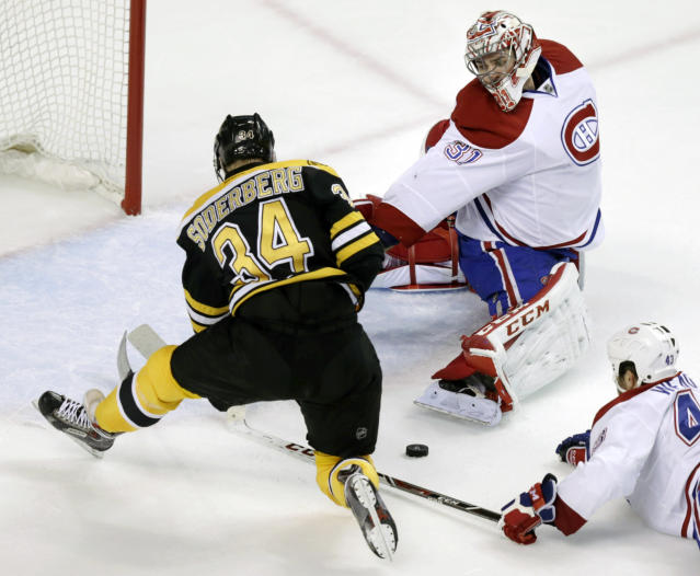 Montreal Canadiens goalie Carey Price (31) reaches back to make a save on a shot by Boston Bruins center Carl Soderberg (34) during the second period of Game 1 in the second-round of a Stanley Cup playoff series in Boston, Thursday, May 1, 2014. (AP Photo/Charles Krupa)