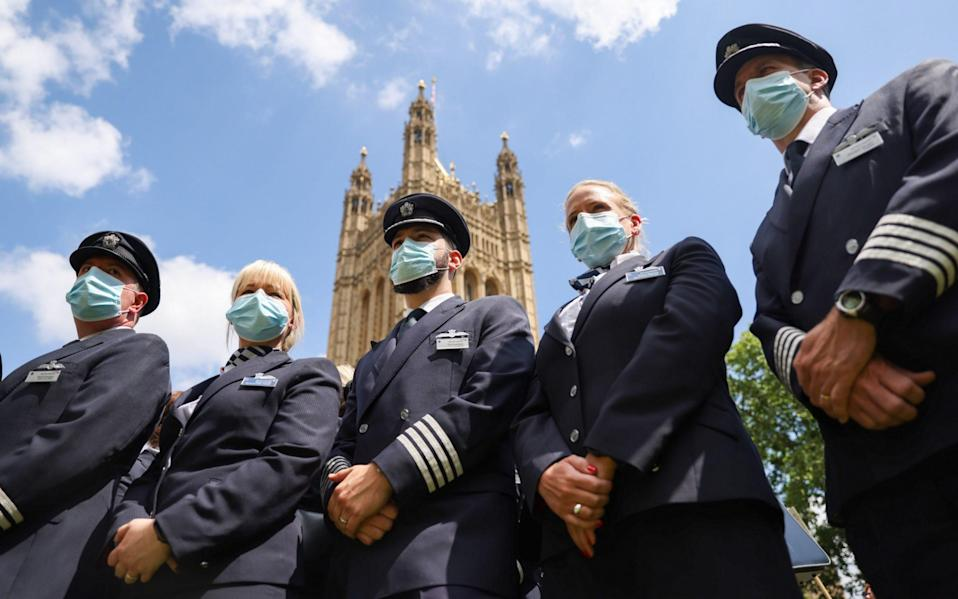 Protesters from British Airways stand near the Houses of Parliament
